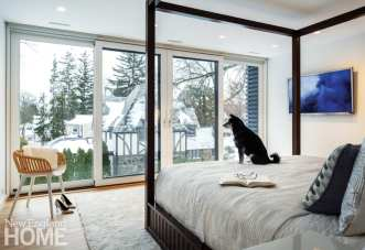 Her parents (and dog Sasha) got a new master suite on the second floor of the addition, with privacy shades that descend from a recess in the ceiling.