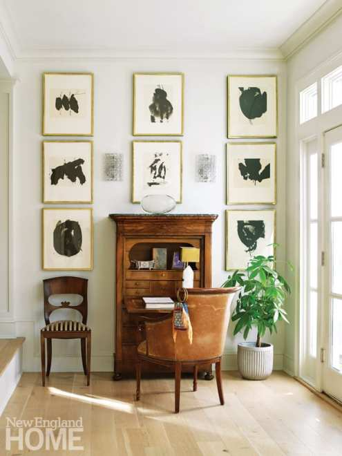 desk and chairs surrounded by Robert Motherwell prints