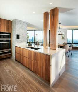 Another view of the kitchen with walnut cabinets and white counters