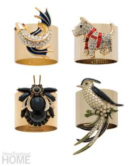 Napkin rings featuring jeweled a koi fish, a beetle, a scottie dog, a crab and a bird