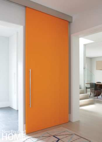 The mudroom's colorful door gives notice that this is a modern house.