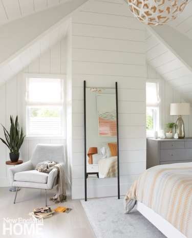 A standing mirror visually enhances the size of a daughter's room.