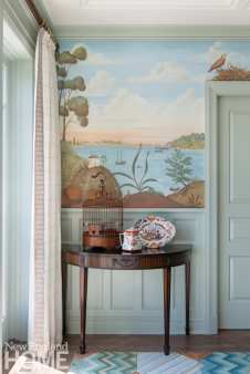 Detail of side table and mural featuring boats on the water