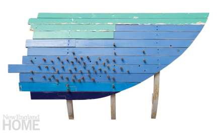 "Spiles (2012), found painted wood and spiles, 52""H × 30""W × 12""D"