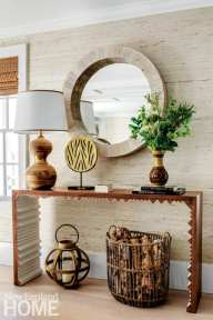 A Newport vacation's home accent table with a mirror above it