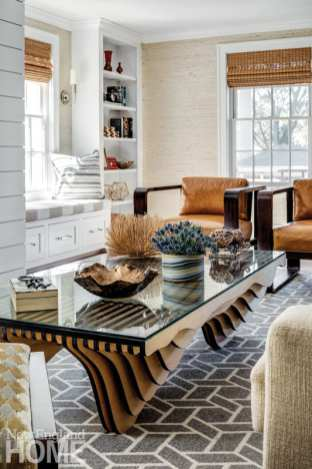 a newport vacation home's living room with glass-topped coffee table