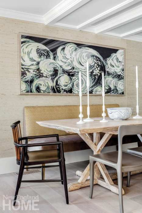 a newport vacation home's dining room table and banquette