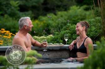 couple soaking in pool