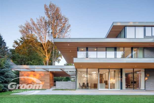 cost to build a modern home outside evening