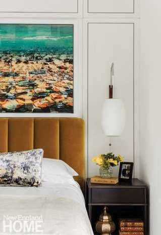 Daher added wall panels with bronze inserts to give the bedroom more interest.