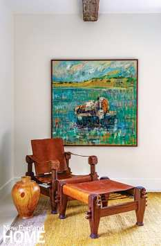 Midcentury rosewood campaign chair and contemporary art
