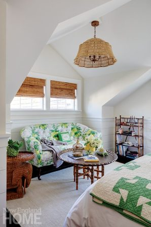 Nantucket master bedroom with green floral couch.