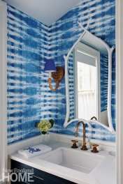 Powder room with batik style wallpaper