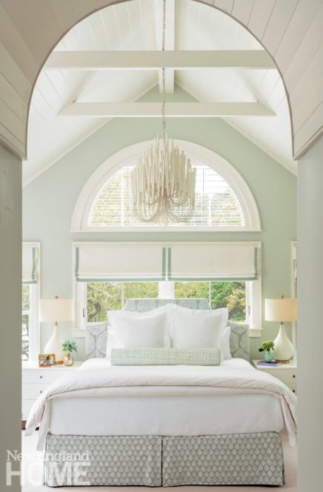 Bedroom with pale green walls and white bedding
