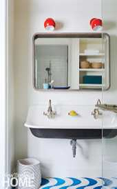 Children's bathroom with blue and white tile and blue sink