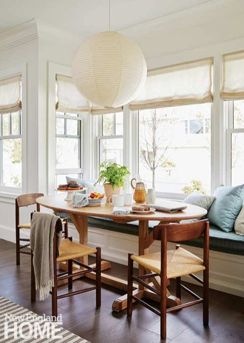 Dining nook with large white paper lantern