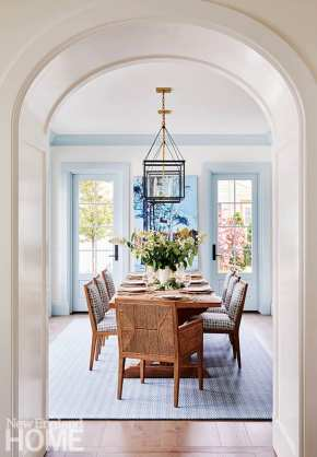 Dining room with white walls and light blue trim