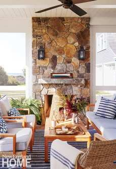 Three season porch with stone fireplace