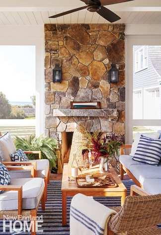 Three season porch with stone fireplace