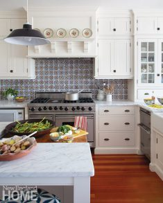 Skok splurged on handmade red-and-blue Portuguese tiles for the backsplash. She discovered the tin schoolroom pendants in London, where she began her design career.