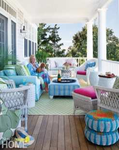 "The covered porch features a collection of wicker and a Crate & Barrel sofa that Skok reupholsters every five or six years. ""Snoozing there in the afternoon is the most luxurious thing,"" she says."