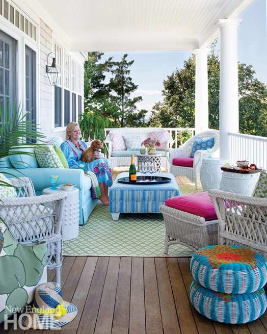 """The covered porch features a collection of wicker and a Crate & Barrel sofa that Skok reupholsters every five or six years. """"Snoozing there in the afternoon is the most luxurious thing,"""" she says."""