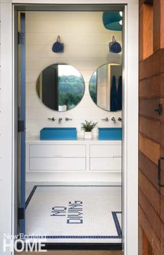 After a dip in the pool—or lake—swimmers can freshen up at one of the cabana's blue Whyte & Co. sink basins, which sit atop custom floating vanities.
