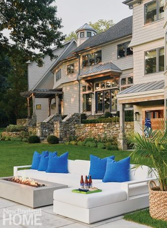 A Holly Hunt sectional surrounds a firepit from Restoration Hardware.