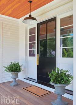 The porch runs along the front of the house and wraps around one side.