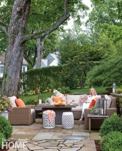 Interior designer in her Southport, Connecticut interior designer Nany Monhan on her outdoor patio