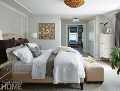 Neutral bedroom with gray and white bedding