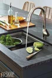 Kitchen sink with black quartz countertop.