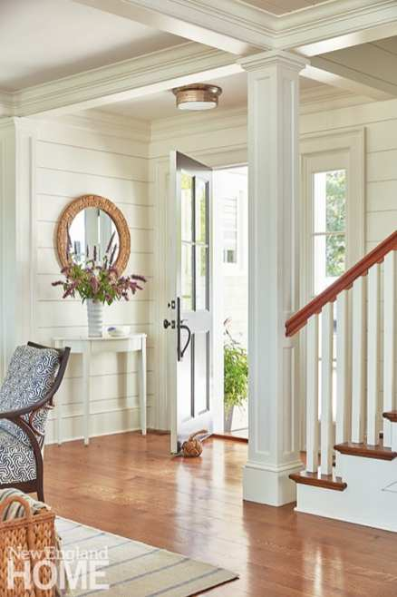 """Nickel-gap paneling helps """"bring the outdoors in,"""" according to the owners' wishes, while stained walnut hardwoods provide contrast with the otherwise light-and-bright interior."""