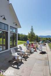 The swimming pool terrace, raised a full story above the sloping knoll, is a belvedere with commanding views of the landscape.