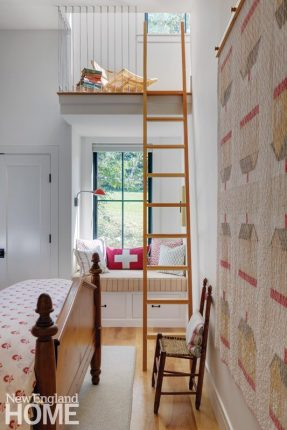 The small guestroom, with its antique furniture and quilt, features a partially hidden sleeping loft.