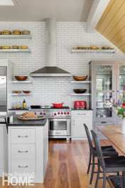 The owner's collection of vintage picnic baskets and delightfully domestic mochaware is on display, but otherwise the kitchen, designed by Robyn Keeler of Keeler Concepts by Design, is a serious chef's work place.