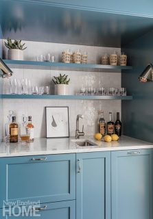 A wet bar gets splashed with Charlotte Slate by Benjamin Moore for a shot of color.