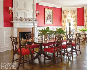 The dining room's walls are upholstered in a vibrant glazed linen by Pierre Frey, outlined in a chocolate double-welt trim by Samuel & Sons. The table and chairs are late eighteenth-century designs.