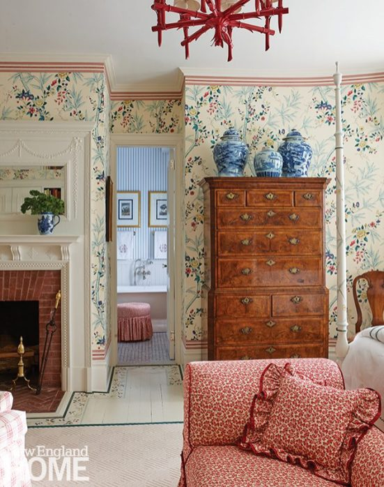 An exquisite, stalwart eighteenth-century English burled-walnut highboy is the star of the main bedroom and is the perfect foil for the patterned upholstery and scenic wallpaper.