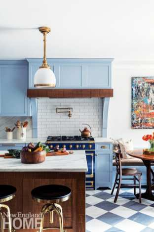 """""""The Visual Comfort pendant lights look as though they could have come from a train station,"""" says designer Dean Sawyer, who collaborated with homeowner Emily Rives on the fixtures and finishes."""