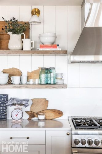 """""""I love Nikki's style. It's stylish but not fussy,"""" homeowner Kristen Hartz says. The Orient Express counter stools are woven from family-friendly synthetic rope."""