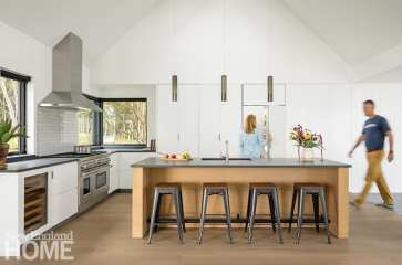 White contemporary kitchen with wood island