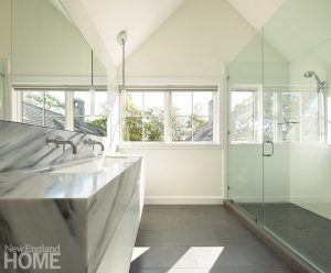 Contemporary white bathroom with floating marble vanity
