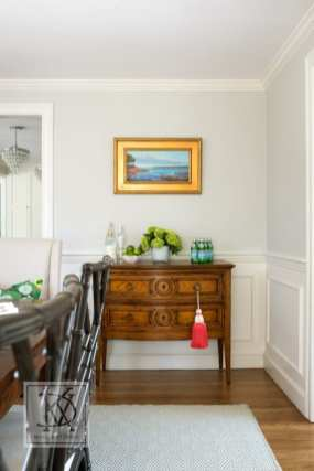 An antique chest keeps dishes and serving utensils at-the-ready in a North Shore dining room.