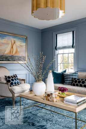 A room painted in New Hope Gray by Benjamin Moore is a soothing retreat for the homeowners.
