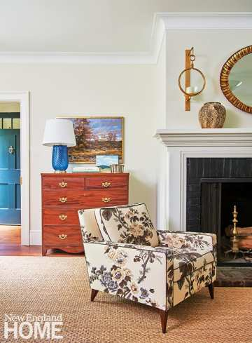The living room's original wood-burning fireplace from 1760 was preserved and repainted.