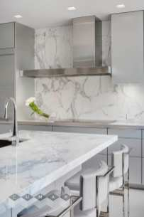 Countertops: Calacatta Marble with mitre joint edge detail. Design: Rosemary Porto, Poggenpohl. Builder: FBN Construction. Photography: Greg Premru.