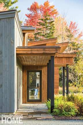 The variously slanted or pitched roofs are layered to create a sense of movement when viewed from the home's bluestone-paved entryway.
