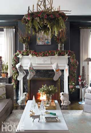 Painted Farrow & Ball's Black Blue, the library is now the Winchester family's favorite room, especially when stockings are hung from a mantel decorated by Jennifer Figge with curly willow, magnolia, and pheasant-feather arrangements beside a ribbon-wrapped garland.