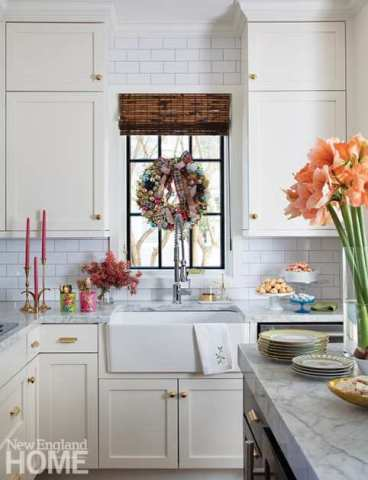 In the kitchen, amaryllis 'Rilona' provides a bundle of festivity. But all eyes naturally turn to the wreath crafted by New Hampshire designer Emma Carole Paradis of Impeccable Nest.